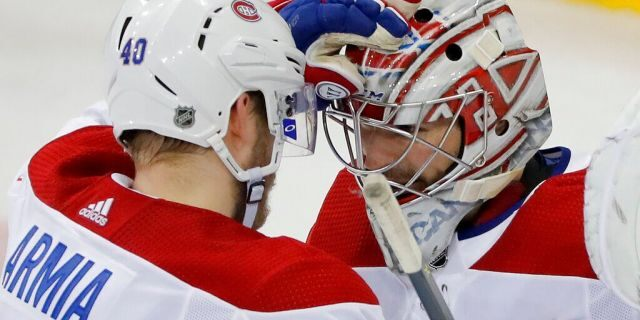 Montreal Canadiens right wing Joel Armia (40) celebrates with goaltender Carey Price (31) after the Canadiens beat the New York Rangers 4-2 in an NHL hockey game, Friday, March 1, 2019, in New York. (AP Photo/Julie Jacobson)