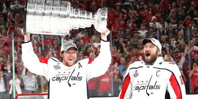Alex Ovechkin #8 hands of the Stanley Cup to Nicklas Backstrom #19 of the Washington Capitals after their team's 4-3 win over the the Vegas Golden Knights in Game Five of the 2018 NHL Stanley Cup Final at T-Mobile Arena on June 7, 2018 in Las Vegas, Nevada. (Photo by Bruce Bennett/Getty Images)