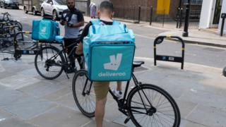 Deliveroo riders taking a break