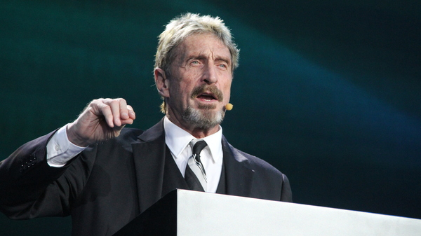John McAfee giving a speech on Aug. 16, 2016, in Beijing, China. McAfee has been arrested on tax evasion charges in Spain.