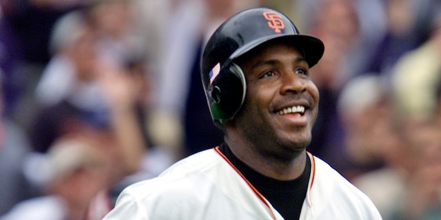 San Francisco Giants' Barry Bonds smiles as he begins to round the bases after he hit his 73rd home run of the season, against the Los Angeles Dodgers in a baseball game in San Francisco on Oct. 7, 2001.  (AP Photo/Eric Risberg, File)