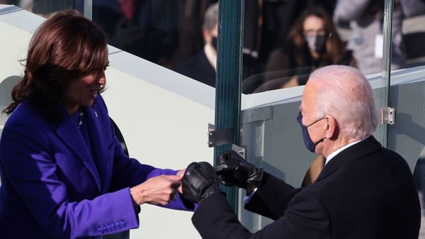 Vice President Harris celebrates with the incoming president after being sworn in Wednesday on the West Front of the U.S. Capitol.