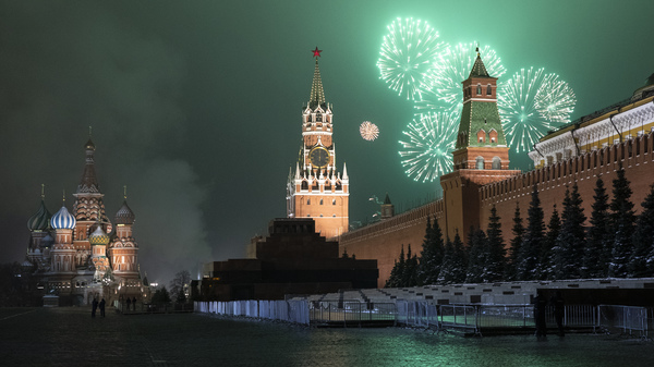 Fireworks explode over the Kremlin and Red Square during New Year