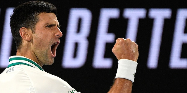 Serbia's Novak Djokovic reacts after winning a point against Russia's Daniil Medvedev in the men's singles final at the Australian Open tennis championship in Melbourne, Australia, Sunday, Feb. 21, 2021.(Associated Press)