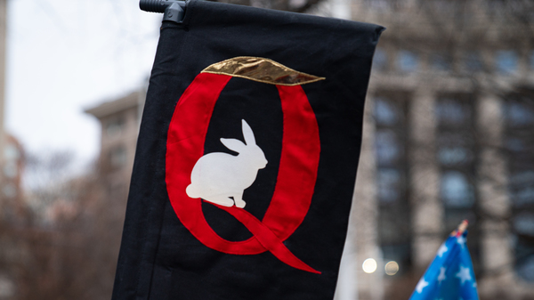 QAnon supporters attended a pro-Trump rally last month in Washington, D.C., on the same weekend that Congress finalized then-President-elect Joe Biden