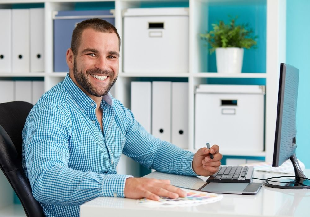 Happy graphic designer working for windows