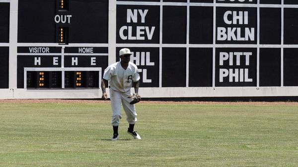 Birmingham Barons outfielder Luis Basabe moves toward a ball in front of the vintage scoreboard in 2019 at Rickwood Field, America