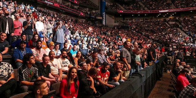 Fans attend a UFC 261 mixed martial arts event Saturday, April 24, 2021, in Jacksonville, Fla. The sold-out event touted as the first full-capacity sporting event held indoors in more than a year drew a star-studded crowd. (Associated Press)