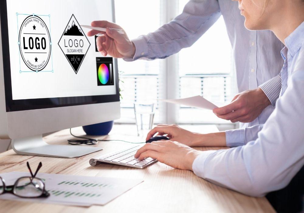 Designer team sketching a logo in digital design studio on computer