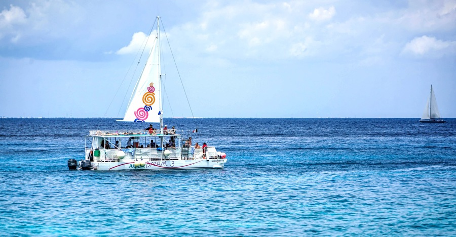 things to do in cozumel go sailing on a catamaran