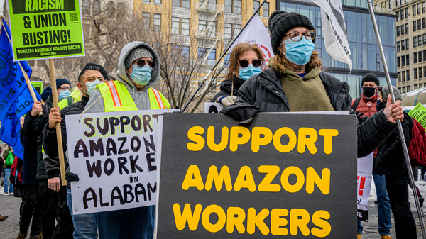 Members of the Workers Assembly Against Racism gather across from an Amazon-owned Whole Foods Market in New York City as part of a nationwide solidarity event with Amazon workers seeking to unionize in Bessemer, Ala., on Feb. 20.