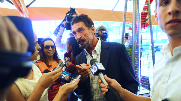 John McAfee talks to the media outside Beacon Hotel where he stayed after arriving from Guatemala in December 2012 in Miami Beach, Fla. McAfee was found dead in a Spanish prison cell on Wednesday, according to his lawyer.