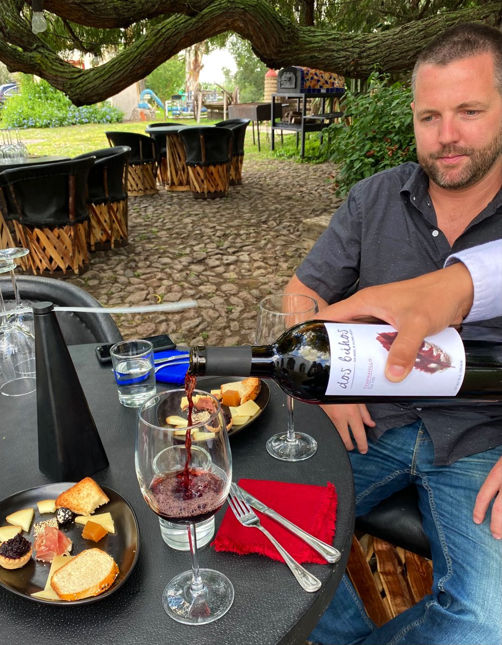 drinking wine at dos buhos winery in guanajuato mexico