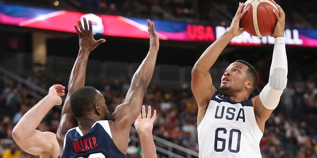 Team White guard Jalen Brunson (60) goes up for a shot under pressure from Team Blue guard Kemba Walker (26) during the first half of the U.S. men's basketball team's scrimmage in Las Vegas, Friday, Aug. 9, 2019. (Associated Press)