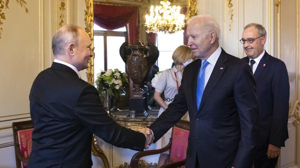 U.S. President Biden and Russian President Vladimir Putin shake hands as Swiss President Guy Parmelin (right) looks on during the U.S.-Russia summit at Villa La Grange on June 16 in Geneva, Switzerland.