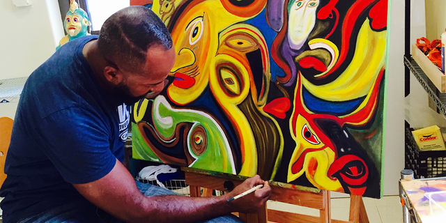 Retired Army Staff Sergeant Alfredo De los Santos working on one of his pieces.