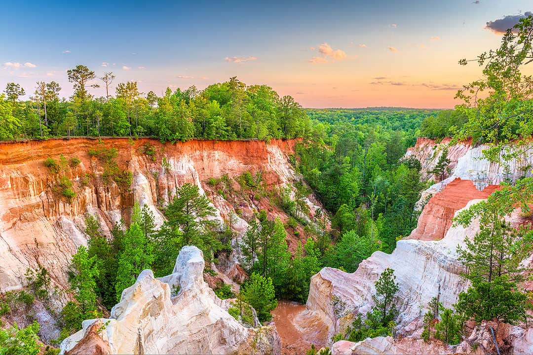 """Providence Canyon State Park is also referred to as the """"Little Grand Canyon"""" of Georgia. It offers the most picturesque views with tones of orange, pink, and red"""